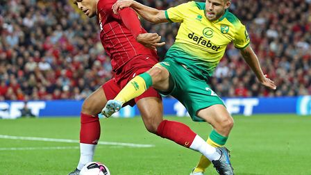 Welcome to the Premier League. Teemu Pukki tussles with Liverpool's world class defender Virgil van