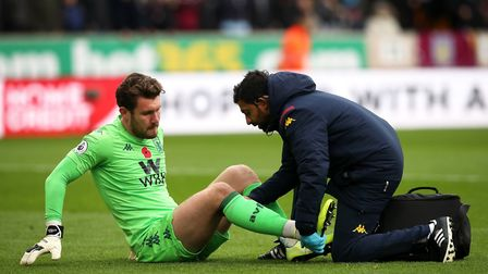 Jed Steer is treated for the injury just minutes into the game against Wolves Picture: PA