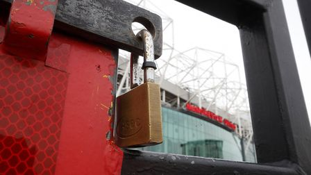 Locked gates ouitside Old Trafford, home of Manchester United Picture: PA