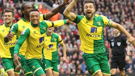 Former Norwich City skipper Russell Martin celebrates a famous goal at Liverpool Picture: Paul Chest