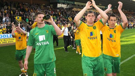Michael Nelson, Grant Holt and Adam Drury savour the moment Picture: Archant