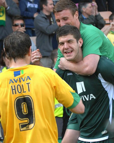 Declan Rudd and Grant Holt congratulate keeepr Fraser Forster Picture: Archant
