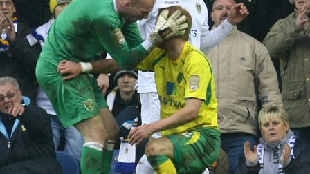 Norwich's John Ruddy congratulates Zak Whitbread on a good challenge during the Championship match a