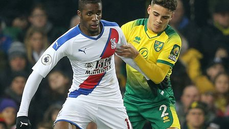 Max Aarons tussles with Crystal Palace's Wilfried Zaha during a 1-1 Premier League draw at Carrow Ro