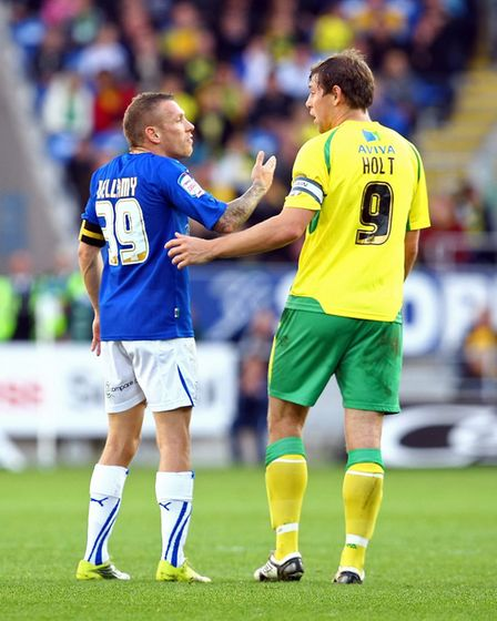 Grant Holt trying to get a word in with Cardiff skipper Craig Bellamy Picture: Paul Chesterton/Focus