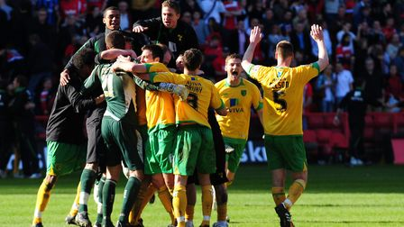 The party begins as Norwich City players celebrate victory at Charlton Picture: Alex Broadway/Focus