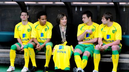 Delia Smithchats to some of the Norwich City players during the launch of the new home kit. From lef