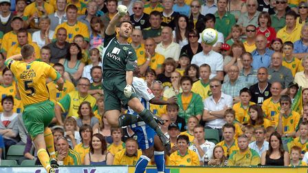 Norwich 'keeper Michael Theoklitos misses the ball for the first Colchester goal back on opening day