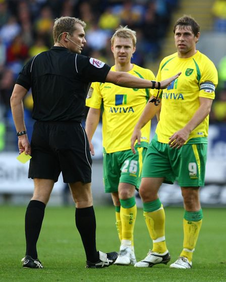 Cardiff - Saturday October 30th, 2010: Norwich Captain Grant Holt has a word with the ref after Step