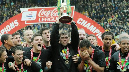 Norwich City skipper Grant Holt lifts the League One trophy at Carrow Road in 2010 Picture: Nick But