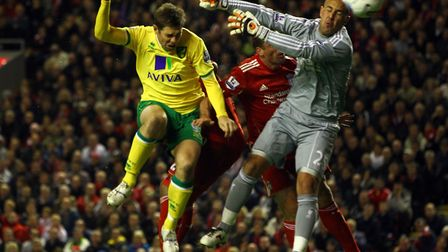 Grant Holt came off the bench to score an equaliser for Norwich at Liverpool in the Premier League i