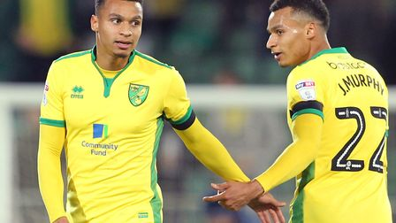 Josh, left, and Jacob Murphy celebrate City's 5-0 Championship win over Brentford at Carrow Road in