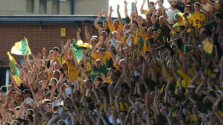 Travelling fans celebrate Norwich's win at Watford in 2004 Picture: Archant