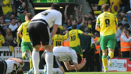 Simeon Jackson heads towards the Snakepit after his late, late winner Picture: Archant