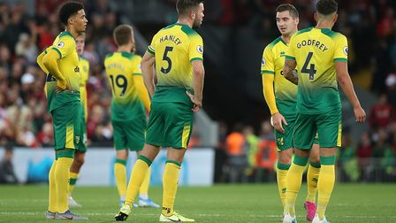 A tough introduction to Premier League life for Norwich City back in August at Anfield Picture: Paul