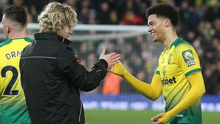 Goal-scorer Jamal Lewis, right, and Todd Cantwell celebrate after Norwich City's last home game, a 1