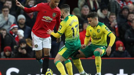Emi Buendia and Max Aarons, right, try to keep up with Manchester United star Marcus Rashford during