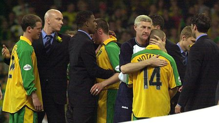Nigel Worthington comforts Alex Notman after Norwich City lost their promotion play-off final at the