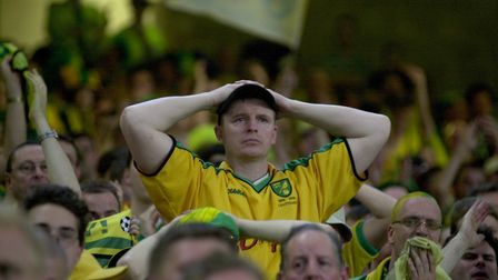 Tense times for the travelling Norwich fans Picture: Archant