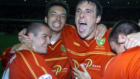 Malky Mackay, right, celebrates with Alex Notrman, left, and Clint Easton after securing a place in