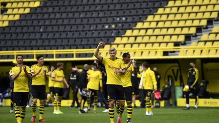 Dortmund's Erling Haaland and his team-mates celebrate victory over Schalke ... in front of empty st