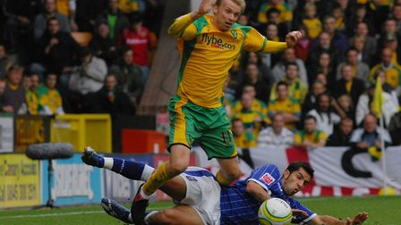 Luke Chadwick is sent flying by Ipswich's Pablo Counago during his Norwich City debut Picture: Archa