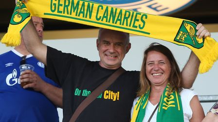 Paul Standley with a German Canaries flag as Norwich City took on Schalke during their pre-season to