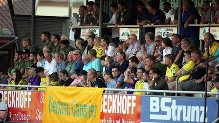 A banner for the German Canaries in front of City players, coaches and fans during a friendly agains