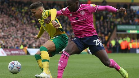 Bright Osayi-Samuel challenges City defender Max Aarons during QPR's 4-0 defeat at Carrow Road in Ap