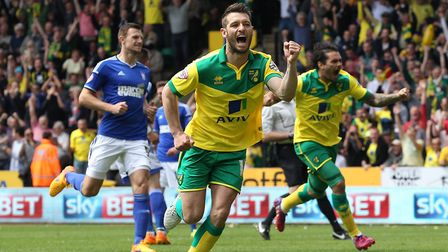Wes Hoolahan celebrates after scoring from the spot, moments after Christophe Berra saw red Picture: