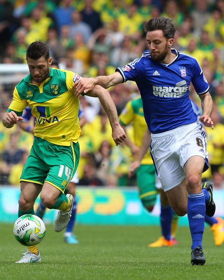 Wes Hoolahan keeps Cole Skuse at bay Picture: Paul Chesterton/Focus Images Ltd