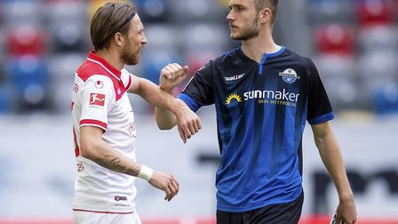 Former Norwich City striker Dennis Srbeny, right, greets an opposition player ahead of Paderborn's 0