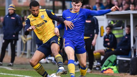 Norwich City loanee Simon Power in action during his successful loan spell with King's Lynn Town Pi