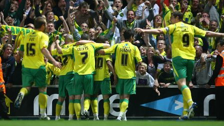 Norwich players enjoy the moment after Simeon Jackson gets goal number three at Ipswich Picture: Pau