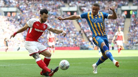 Carlton Morris, right , in action for Shrewsbury agaimst Rotherham in the Checkatrade Trophy final a