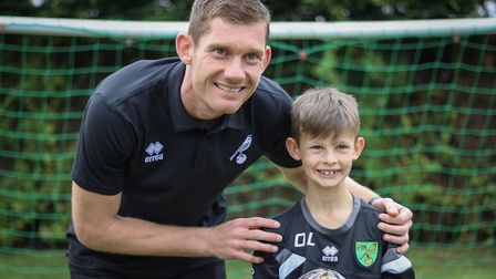 Canaries goalkeeper Michael McGovern with a young fan at Norwich City Fans Social Clubs Family Fun D
