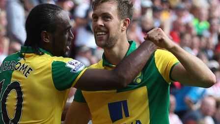 Steven Whittaker, right, celebrates with Cameron Jerome after scoring during Norwich Citys 3-1 Premi