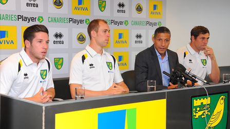 Steven Whittaker alongside manager Chris Hughton after joining Norwich in 2012, alongside fellow new