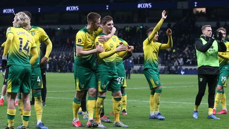Norwich City's players celebrate victory at Tottenham Hotspur in the FA Cup fifth round Picture: Pau