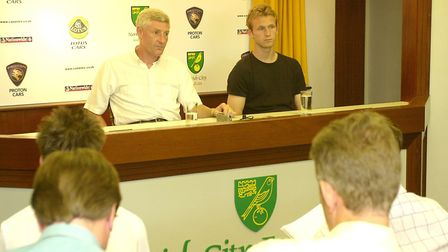 17-year-old Ryan Jarvis (R) sits next Norwich City Manager Nigel Worthington to face the media after