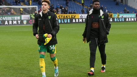 Josh Martin and veteran midfielder Alex Tettey - Martin is hoping to be a part of City's survival ba