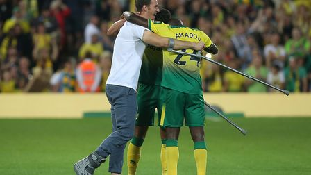 Christoph Zimmermann didn't let crutches get in the way of him congratulating his City team-mates Pi
