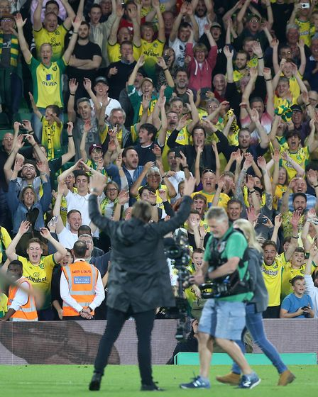 Daniel Farke does his trademark celebration with all four sides of the ground after the win over Man