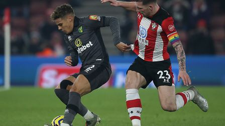 Max Aarons of Norwich and Pierre-Emile Hojbjerg of Southampton, right, in action during the Saints'