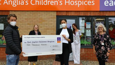 Tom Trybull presents a donation of £5,000 to East Anglia's Children's Hospices Picture: Norwich City