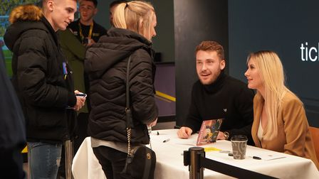 Tom and Anna Trybull signed copies of Mrs Trybull's children's book at Norwich City's fan hub in Nor
