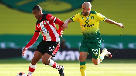 Teemu Pukki tries to get the better of Southampton's Yan Valery Picture: PA