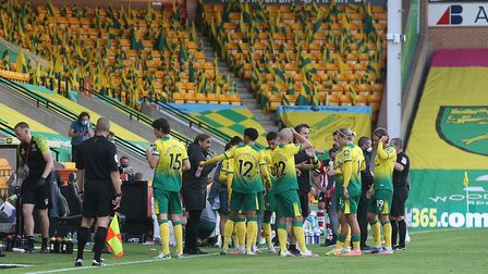 Norwich players take a drinks break in front of empty stands at Carrow Road Picture: Paul Chesterton