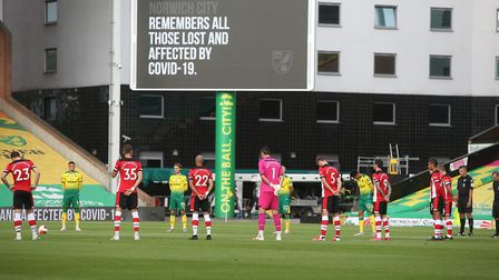 Both sets of players observed a moments silence prior to kick-off. Picture: Paul Chesterton/Focus Im