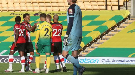 Tim Krul and Max Aarons of Norwich look dejected as the Southampton players celebrate Stuart Armstro
